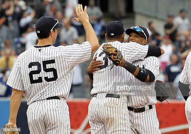 Mark Teixeira Alex Rodriguez and Robinson Cano of the New York Yankees celebrate after defeating the Tampa Bay Rays on September 21 2011 at Yankee...