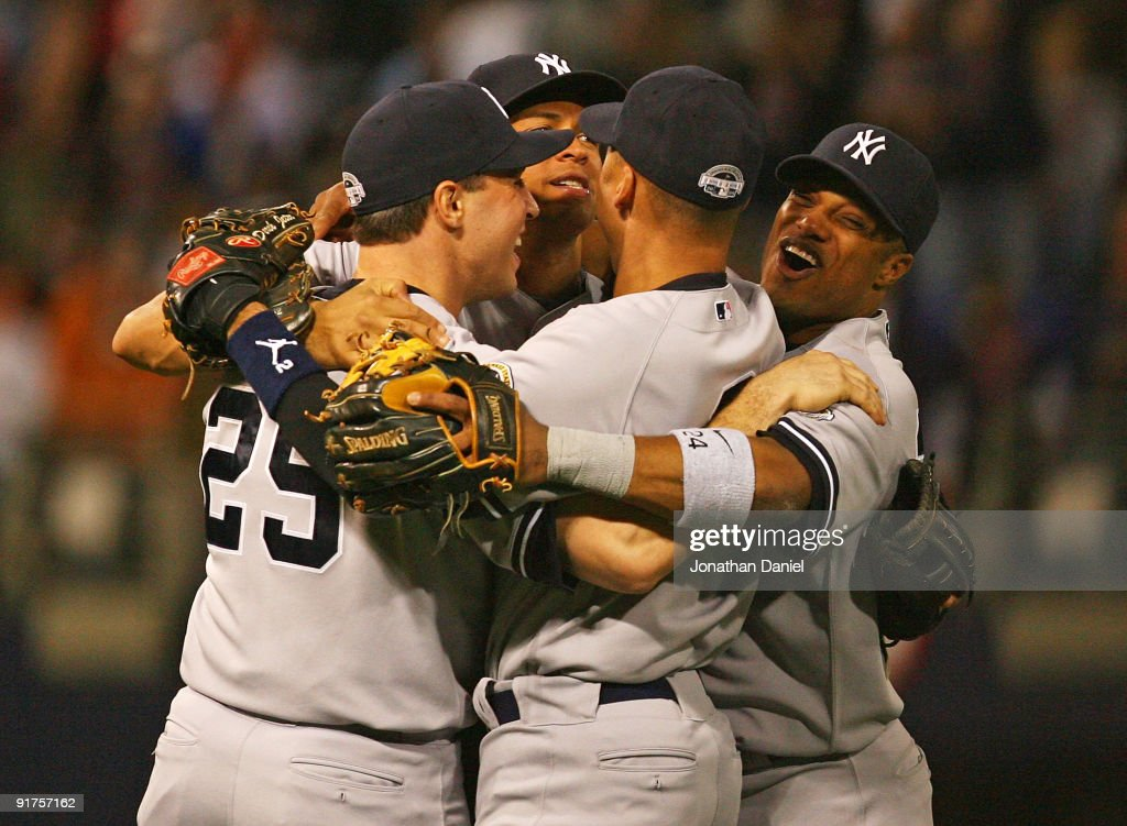 Mark Teixeira #25, Alex Rodriguez #13, Derek Jeter #2 and Robinson Cano #24 of the New York Yankees celebrate a win over the Minnesota Twins in Game Three of the ALDS during the 2009 MLB Playoffs at the Hubert H. Humphrey Metrodome on October 11, 2009 in Minneapolis, Minnesota.