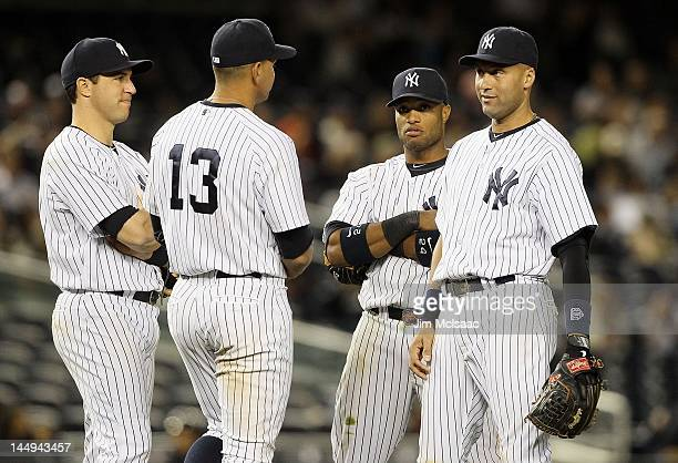 Mark Teixeira Alex Rodriguez Robinson Cano and Derek Jeter of the New York Yankees look on against the Seattle Mariners at Yankee Stadium on May 11...