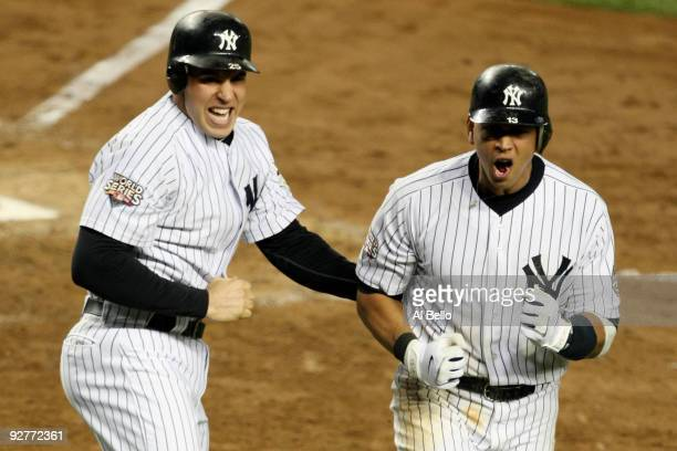 Mark Teixeira and Alex Rodriguez of the New York Yankees celebrate after they scored on a 2-run double by Hideki Matsui in the bottom of the fifth...