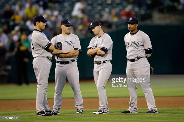 Mark Teixeira Kevin Youkilis Jayson Nix and Robinson Cano of the New York Yankees stand together after Phil Hughes is taken out of the game in the...