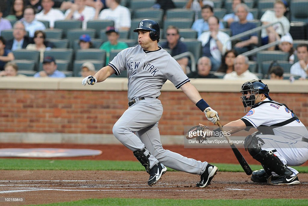 Mark Teixeira #25 of the New York Yankees bats during an MLB game against the New York Mets on May 21, 2010 at Citi Field in the Flushing neighborhood of the Queens borough of New York City.