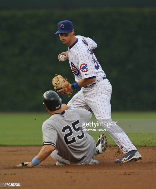 Mark Teixeira of the New York Yankees breaks up a double play attempt by DJ LeMahieu of the Chicago Cubs at Wrigley Field on June 19 2011 in Chicago...