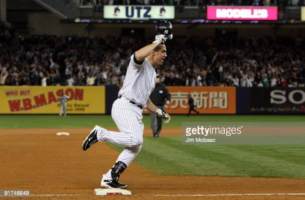 Mark Teixeira of the New York Yankees celebrates as he runs the bases after hitting a walk off home run in the eleventh inning against the Minnesota...
