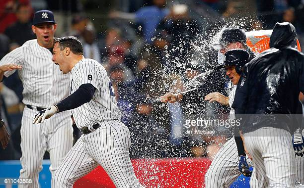 Mark Teixeira of the New York Yankees celebrates his game winning ninth inning grand slam home run against the Boston Red Sox with his teamates at...