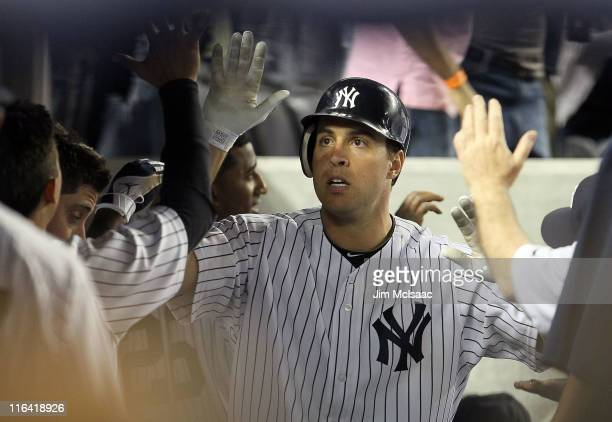 Mark Teixeira of the New York Yankees celebrates his sixth inning two run home run against the Texas Rangers on June 15, 2011 at Yankee Stadium in...