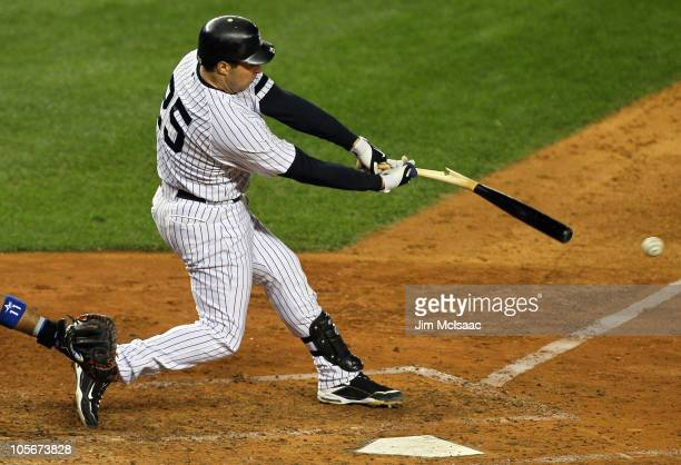 Mark Teixeira of the New York Yankees hits a broken bat ground out to the shortstop in the bottom of the sixth inning against the Texas Rangers in...