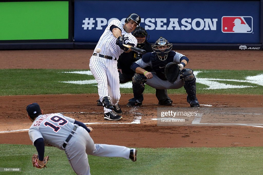 Mark Teixeira #25 of the New York Yankees hits a double in the bottom of the first inning off of Anibal Sanchez #19 of the Detroit Tigers during Game Two of the American League Championship Series at Yankee Stadium on October 14, 2012 in the Bronx borough of New York City.