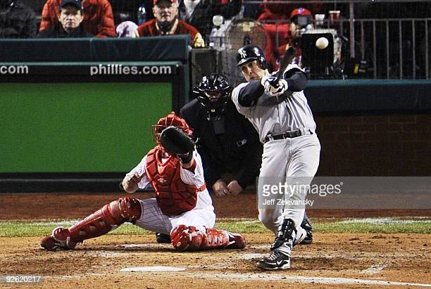 Mark Teixeira of the New York Yankees hits a double in the top of the eighth inning against the Philadelphia Phillies in Game Five of the 2009 MLB...