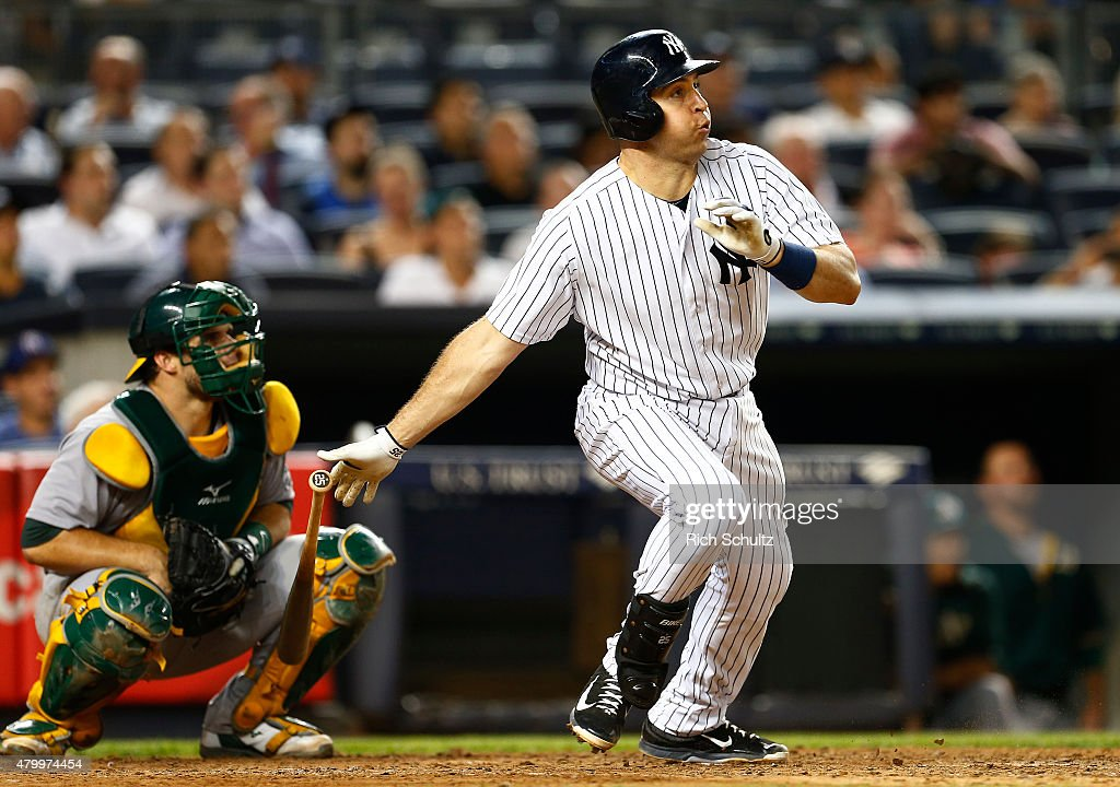Mark Teixeira #25 of the New York Yankees hits a home run against the Oakland Athletics during the sixth inning of a MLB baseball game at Yankee Stadium on July 8, 2015 in the Bronx borough of New York City.