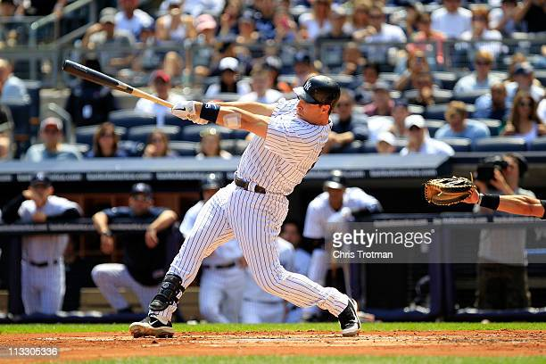 Mark Teixeira of the New York Yankees hits a home run to right center field in the first inning against the Toronto Blue Jays at Yankee Stadium on...