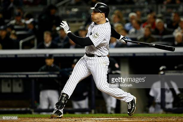 Mark Teixeira of the New York Yankees hits a solo home run in the fourth inning against the Philadelphia Phillies in Game Two of the 2009 MLB World...