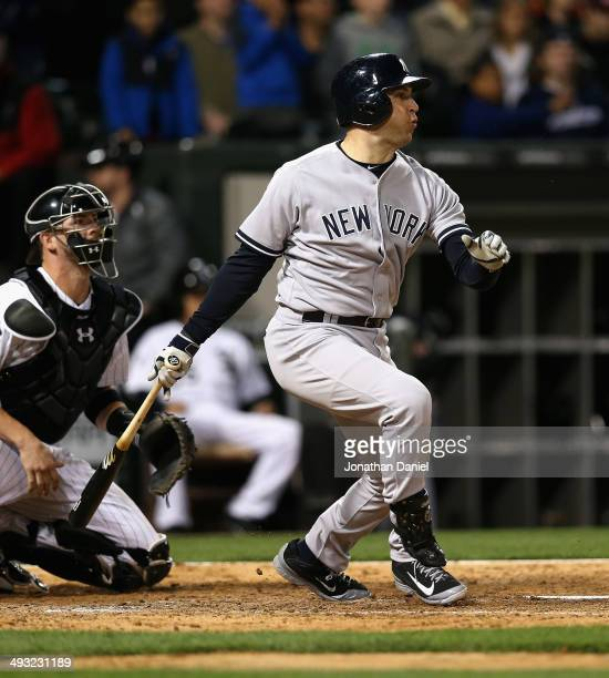 Mark Teixeira of the New York Yankees hits a tworun single in the 9th inning against the Chicago White Sox at US Cellular Field on May 22 2014 in...