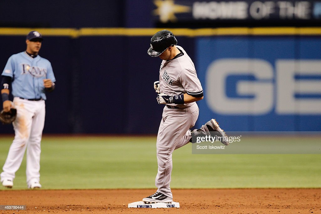 Mark Teixeira #25 of the New York Yankees rounds second base after hitting a home run in the eighth inning against the Tampa Bay Rays at Tropicana Field on August 17, 2014 in St Petersburg, Florida.