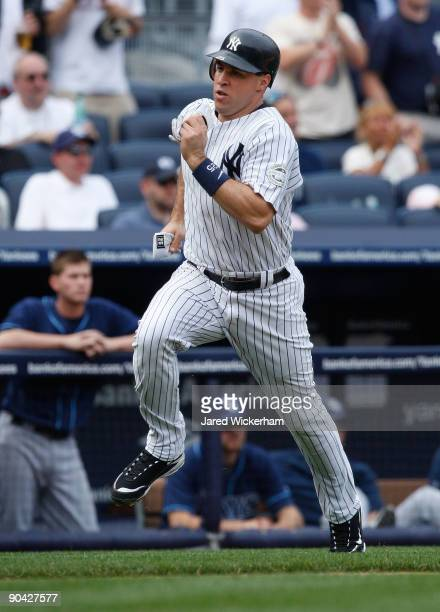 Mark Teixeira of the New York Yankees scores on Jorge Posada's single during the game against the Tampa Bay Rays on September 7, 2009 at Yankee...