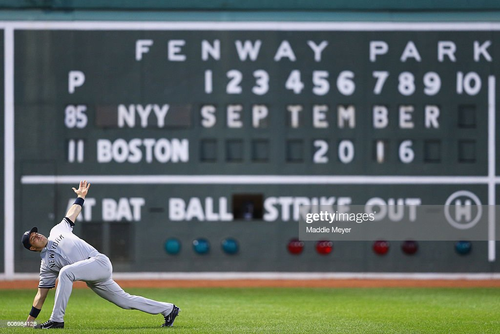 Mark Teixeira #25 of the New York Yankees stretches in front of the Green Monster before the game against the Boston Red Sox at Fenway Park on September 16, 2016 in Boston, Massachusetts.