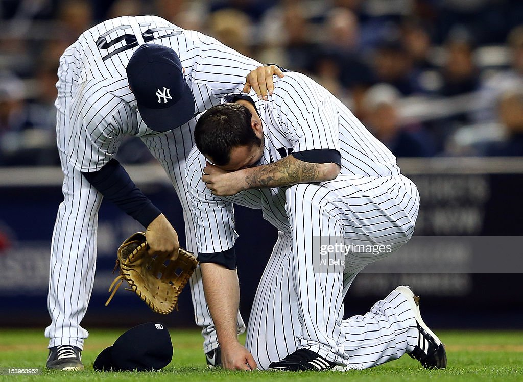 Mark Teixeira #25 of the New York Yankees talks to Joba Chamberlain #62 after he was hit by a broken bat during Game Four of the American League Division Series against the Baltimore Orioles at Yankee Stadium on October 11, 2012 in the Bronx borough of New York City.