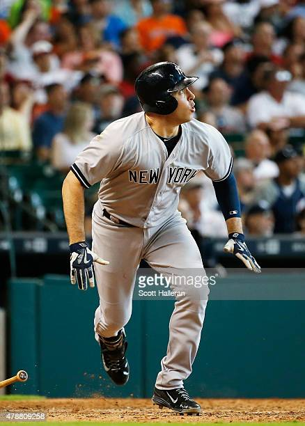 Mark Teixeira of the New York Yankees watches his tworun double in the eighth inning during their game against the Houston Astros at Minute Maid Park...