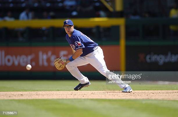 Mark Teixeira of the Texas Rangers lines up a ground ball during the game against the Los Angeles Angels of Anaheim at Ameriquest Field in Arlington...