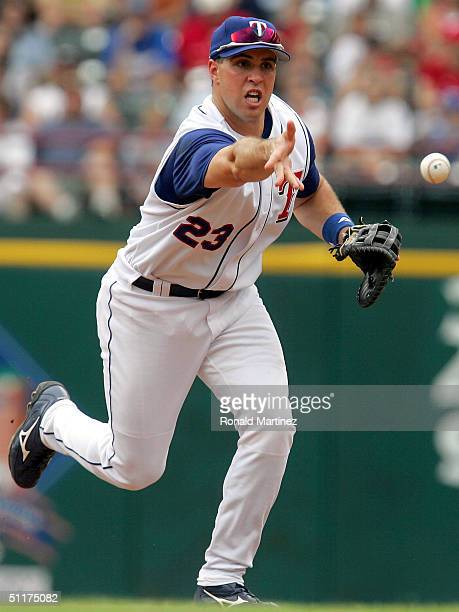 Mark Teixeira of the Texas Rangers makes the out toss to first base during a play against the Tampa Bay Devil Rays on August 15, 2004 at Ameriquest...