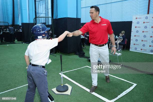 Mark Teixeira providing batting tips to Little League players at the Canon PIXMA Perfect Grand Slam event on June 7 2017 in New York City