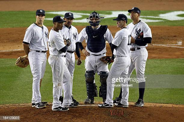 Mark Teixeira Robinson Cano bench coach Tony Pena Russell Martin Jayson Nix and Alex Rodriguez of the New York Yankees look on during a pitching...