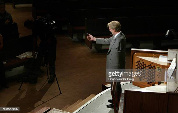 Mark Thallander, takes a bow after his performance at Lake Avenue Church. The former assistant organist at the Crystal Cathedral, lost his left arm...