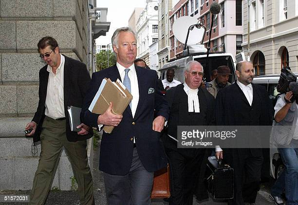 Mark Thatcher arrives at the Cape High Court in Cape Town 26 October 2004 Thatcher arrived at court with his legal team to try and overturn a...