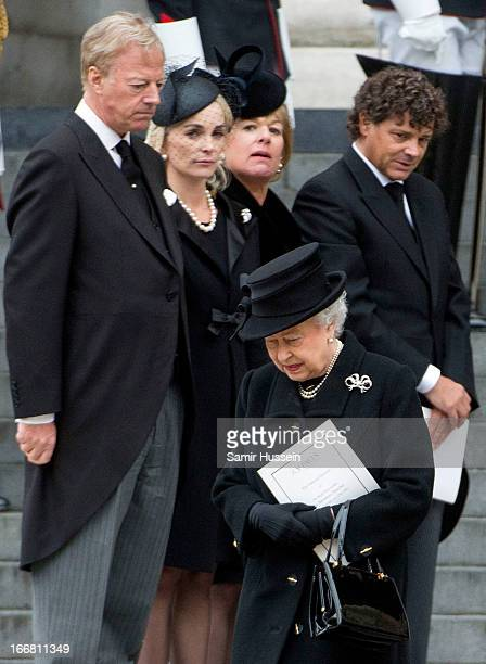 Mark Thatcher Sarah Thatcher Carol Thatcher and Marco Grass look on as Queen Elizabeth II leaves the ceremonial funeral service of former British...