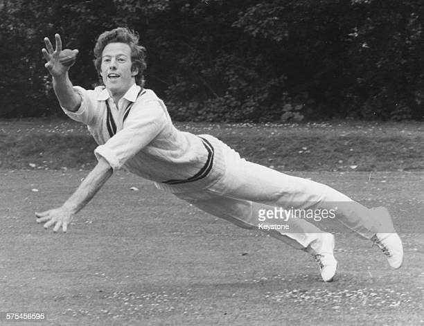 Mark Thatcher son of Opposition Leader Margaret Thatcher diving to make a one handed catch for a Lords and Commons XI during a cricket match at the...