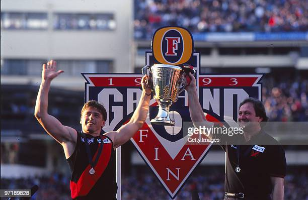 Mark Thompson and Kevin Sheedy of the Essendon Bombers holds aloft the premiership trophy after the 1993 AFL Grand Final between Essendon and Carlton...