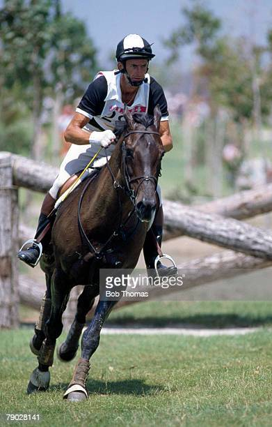 Mark Todd of the New Zealand equestrian team rides his horse 'Charisma' in the three day team eventing competition at the Equestrian events at the...