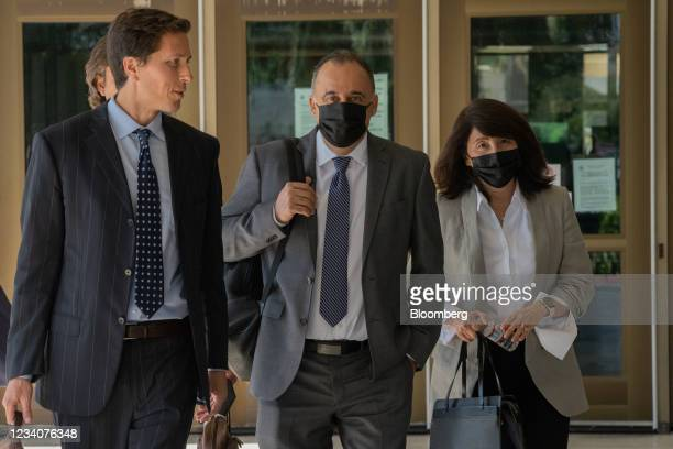 Mark Towfiq, senior vice president of digital technology and experience at PepsiCo, center, and his wife Carol Nakahara, right, leave state court in...