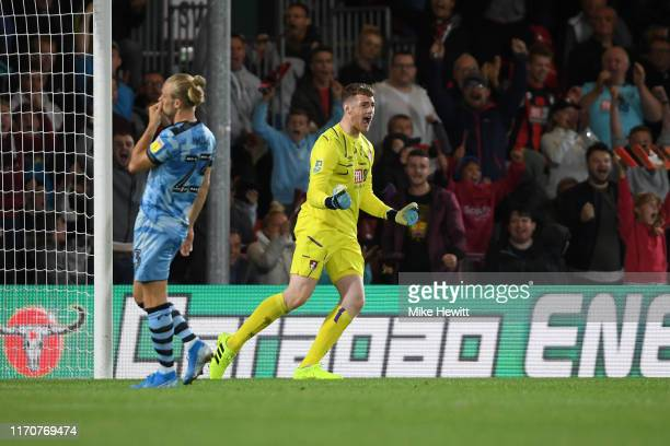 Mark Travers of AFC Bournemouth celebrates saving a penalty from Joseph Mills of Forest Green Rovers during the penalty shootout in the Carabao Cup...