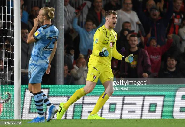 Mark Travers of AFC Bournemouth celebrates saving a penalty from Joseph Mills of Forest Green Rovers during the penalty shoot-out in the Carabao Cup...