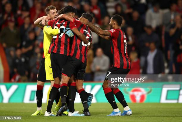 Mark Travers of AFC Bournemouth celebrates with teammates after victory in the penalty shoot-out during the Carabao Cup Second Round match between...