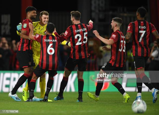 Mark Travers of AFC Bournemouth celebrates with teammates after winning the penalty shoot-out during the Carabao Cup Second Round match between AFC...