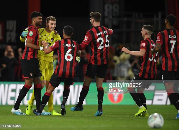 Mark Travers of AFC Bournemouth celebrates with teammates after winning the penalty shootout during the Carabao Cup Second Round match between AFC...