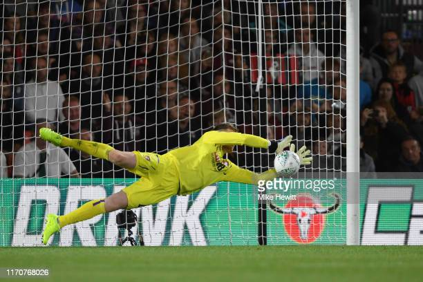 Mark Travers of AFC Bournemouth saves a penalty from Joseph Mills of Forest Green Rovers during the penalty shootout in the Carabao Cup Second Round...