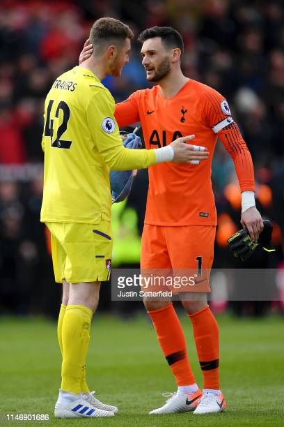 Mark Travers of AFC Bournemouth speaks with Hugo Lloris of Tottenham Hotspur after the Premier League match between AFC Bournemouth and Tottenham...