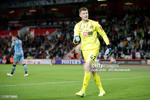 Mark Travers of Bournemouth reacts after he saves his second Forest Green penalty during shootout during the Carabao Cup 2nd Round match between AFC...