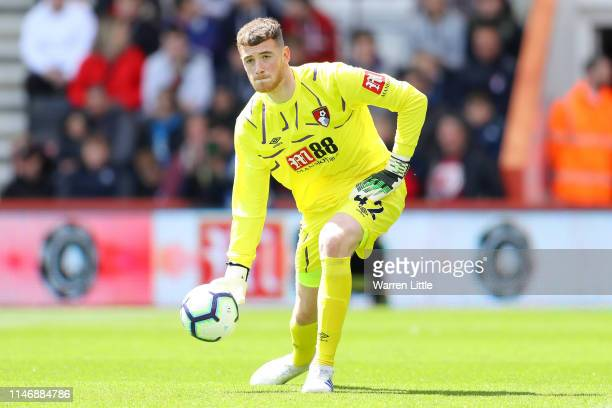 Mark Travers of Bournemouth rolls the ball out during the Premier League match between AFC Bournemouth and Tottenham Hotspur at Vitality Stadium on...