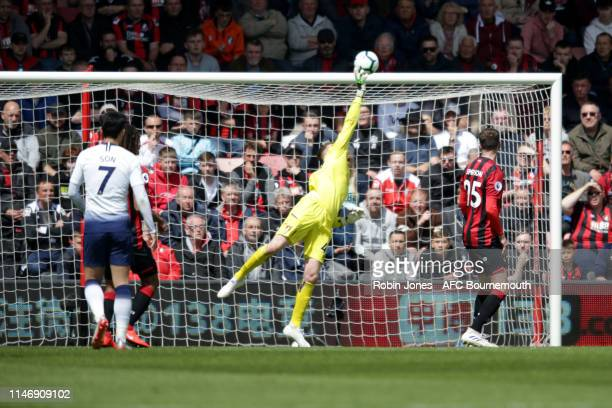 Mark Travers of Bournemouth tips a shot over the bar during the Premier League match between AFC Bournemouth and Tottenham Hotspur at Vitality...