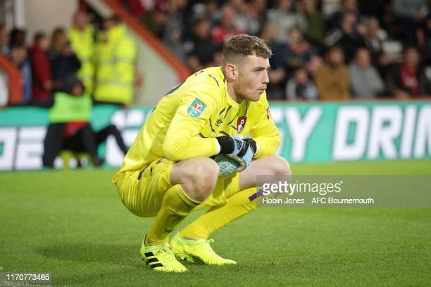 Mark Travers of Bournemouth waits his turn in penalty shootout after match finishes 00 during the Carabao Cup 2nd Round match between AFC Bournemouth...