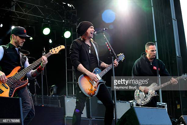 Mark Tremonti Miles Kennedy and Brian Marshall from Alter Bridge performs during the Louder Than Life Music Festival in Champions Park on October 04...