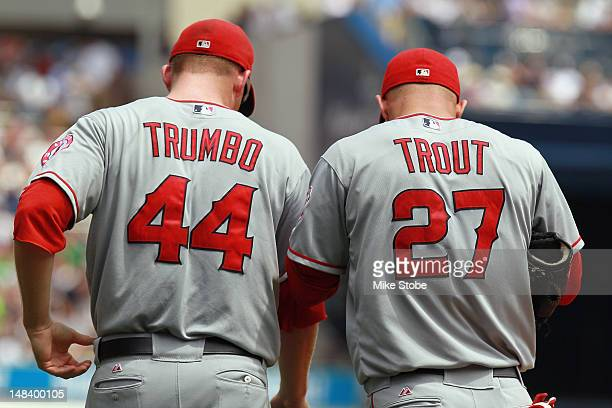 Mark Trumbo and Mike Trout of the Los Angeles Angels of Anaheim looks walk to their positions during the game against the New York Yankees at Yankee...