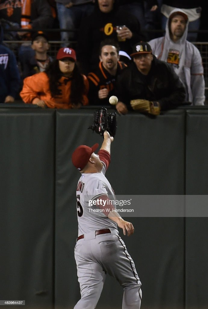 Mark Trumbo #15 of the Arizona Diamondbacks can't catch up to this ball that goes over his head for an RBI double off the bat of Brandon Crawford #35 of the San Francisco Giants in the bottom of the fourth inning at AT&T Park on April 10, 2014 in San Francisco, California.
