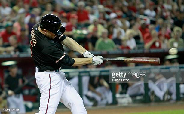 Mark Trumbo of the Arizona Diamondbacks hits a deep fly ball against the Colorado Rockies during the first inning of a MLB game at Chase Field on...