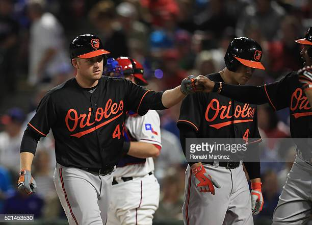 Mark Trumbo of the Baltimore Orioles celebrates a three run homerun against the Texas Rangers in the seventh inning at Globe Life Park in Arlington...