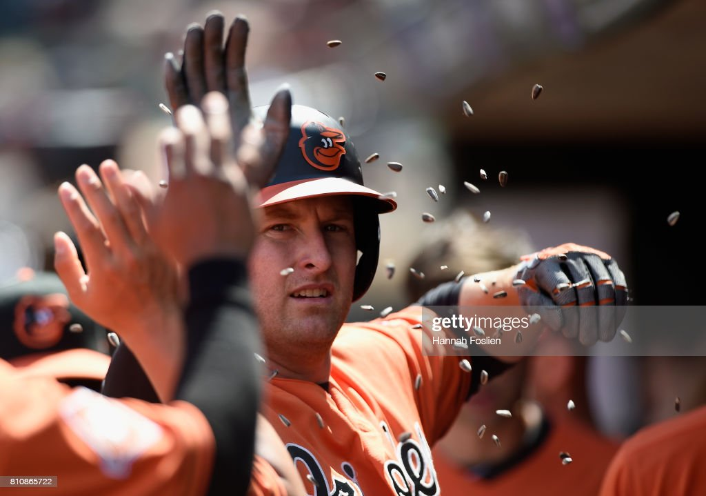 Mark Trumbo #45 of the Baltimore Orioles celebrates hitting a solo home run against the Minnesota Twins during the eighth inning of the game on July 8, 2017 at Target Field in Minneapolis, Minnesota. The Orioles defeated the Twins 5-1.